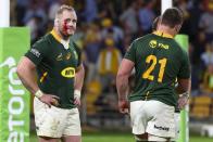 South Africa's Steven Kitshoff, left, reacts following his team's loss to Australia in their Rugby Championship test match in Brisbane, Australia, Saturday, Sept. 18, 2021. (AP Photo/Tertius Pickard)