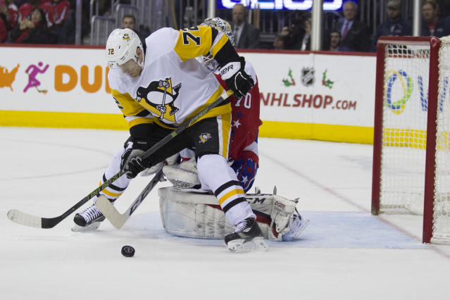 Pittsburgh Penguins right wing Patric Hornqvist (72), from Sweden, works in front of Washington Capitals goaltender Braden Holtby (70) in the first period of an NHL hockey game, Wednesday, Dec. 19, 2018, in Washington. (AP Photo/Alex Brandon)