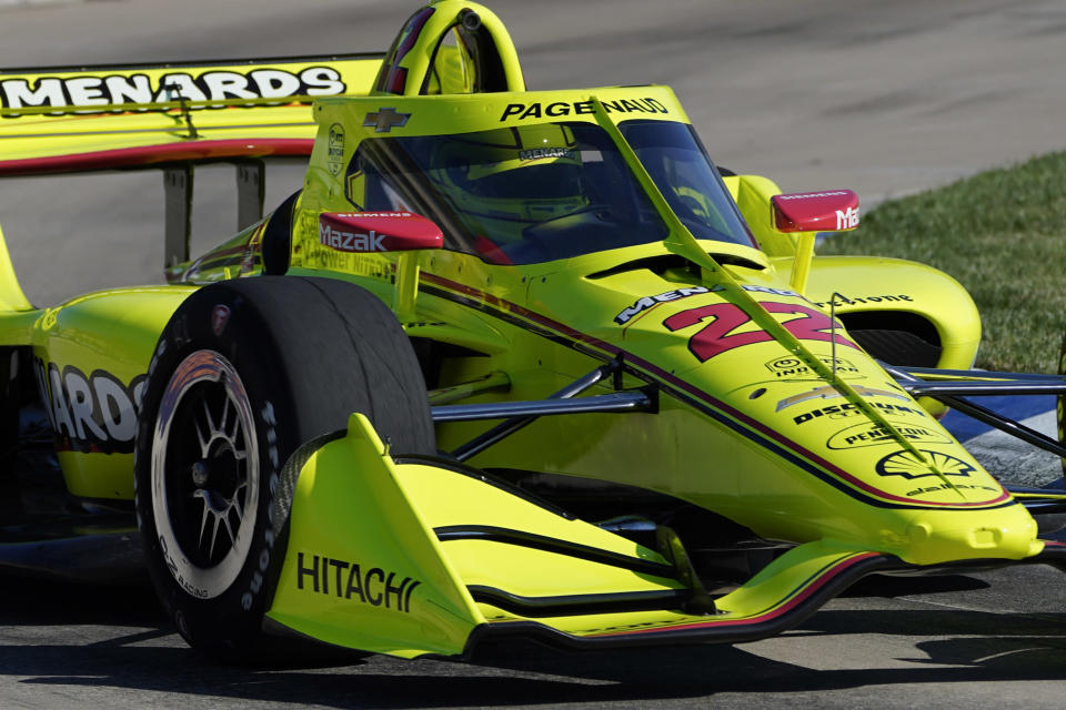 Simon Pagenaud, of France, practices for the IndyCar Detroit Grand Prix auto racing doubleheader on Belle Isle in Detroit, Friday, June 11, 2021. (AP Photo/Paul Sancya)