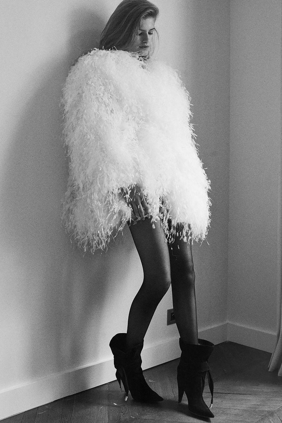 <p>What if the winter bride wanted to stay out all night, dancing until the sun comes up? Of course, the aforementioned king of the after party, Alexandre Vauthier, has you covered for this winter's intimate weddings, too. </p><p>Feathers are a second-dress staple in wedding dressing, but leave it to Vauthier to take plumes and turn the volume way up. And he doesn't want brides to forget the edge, either—hence the black hosiery and easy-to-sport ankle boots. This is Couture with function; you won't need a coat if you opt for an party look this cozy. </p><p>Vauthier gets us; after months of distancing and sheltering in place, we (and brides the world over) just want to party, but we might not be able to do it until December or January. And with the weather in mind, what else would suit a winter dance party better than a mini dress of all-over plumes?! Nothing, it seems. </p>