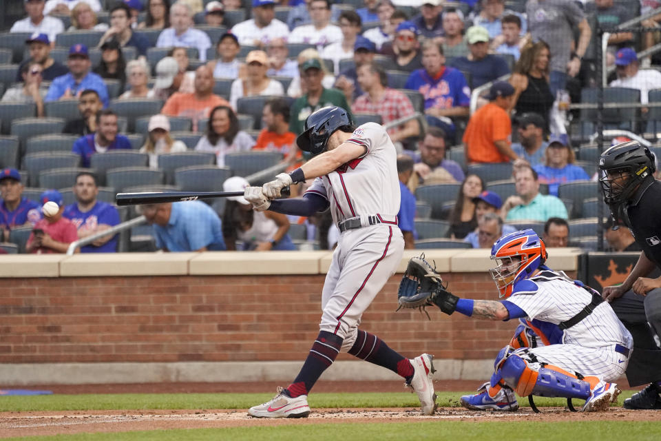Atlanta Braves' Dansby Swanson hits a two-run double in the first inning of a baseball game against the New York Mets, Tuesday, July 27, 2021, in New York. (AP Photo/Mary Altaffer)