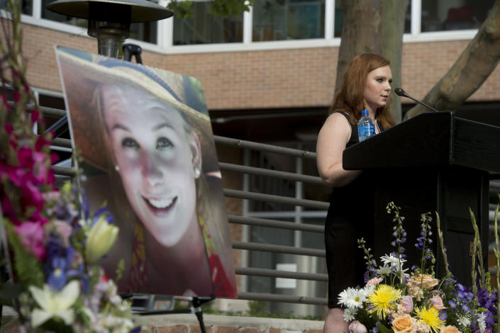 Ashley Fine speaks during a vigil for Mackenzie Lueck at the university in Salt Lake City on Monday, July 1, 2019. Friends and mourners gathered Monday night to remember Lueck, a Utah college student who was missing for nearly two weeks before police arrested a man accused of killing her and burying her charred remains in his backyard. (Jeremy Harmon/The Salt Lake Tribune via AP)