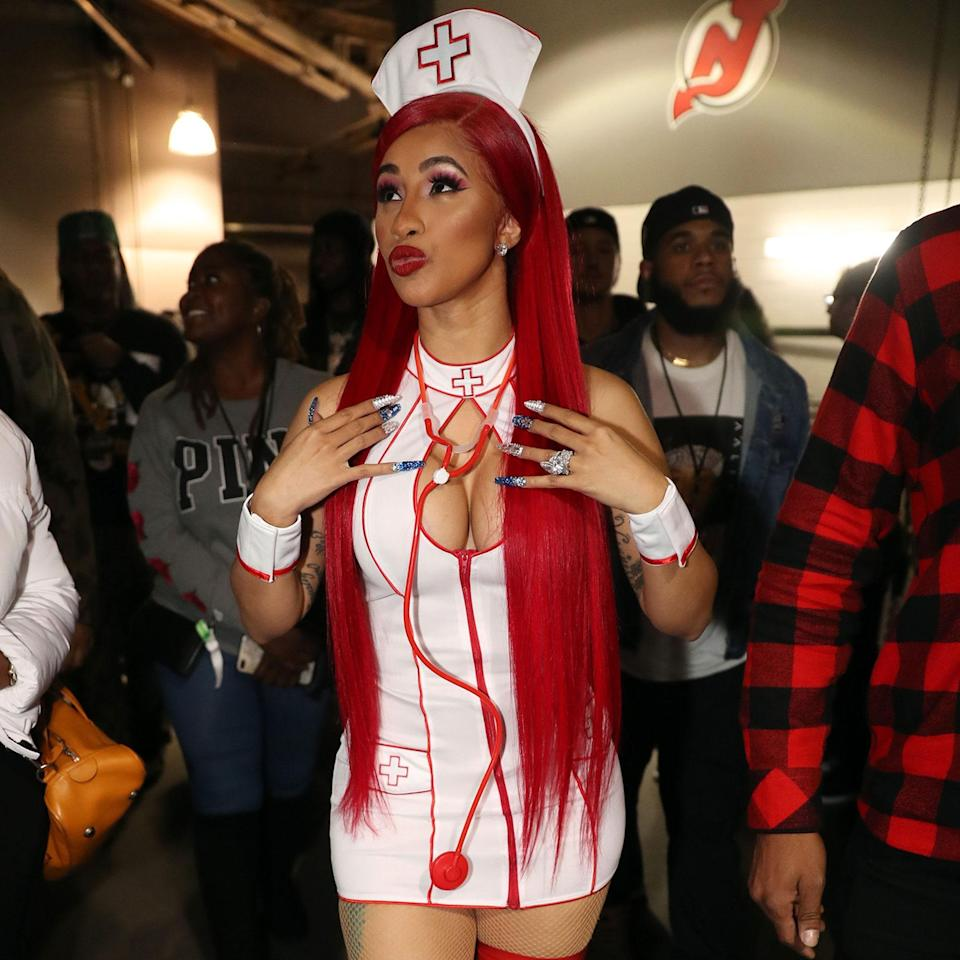 Our <em>regular, degular, shmegular</em> girl from the Bronx arrived at the Powerhouse NYC 2019 concert in this nurse costume just before Halloween. This super straight, waist-length crimson wig matches her outfit and bold rouge lip flawlessly.