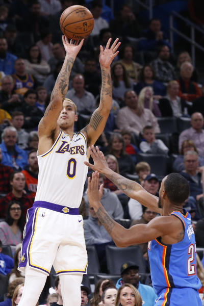 Los Angeles Lakers forward Kyle Kuzma (0) shoots over Oklahoma City Thunder guard Terrance Ferguson, right, in the first half of an NBA basketball game Saturday, Jan. 11, 2020, in Oklahoma City. (AP Photo/Sue Ogrocki)