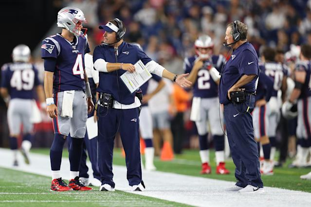 "<a class=""link rapid-noclick-resp"" href=""/nfl/players/31965/"" data-ylk=""slk:Jarrett Stidham"">Jarrett Stidham</a> of the New England Patriots talks with offensive coordinator Josh McDaniels and head coach Bill Belichick (right) during a preseason game last year. (Photo by Maddie Meyer/Getty Images)"