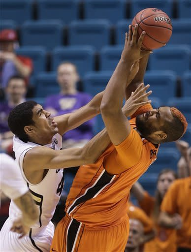 Oregon State's Joe Burton, right, pulls down a rebound against Colorado's Josh Scott in the second half during a Pac-12 tournament NCAA college basketball game on Wednesday, March 13, 2013, in Las Vegas. Colorado won 74-68. (AP Photo/Julie Jacobson)