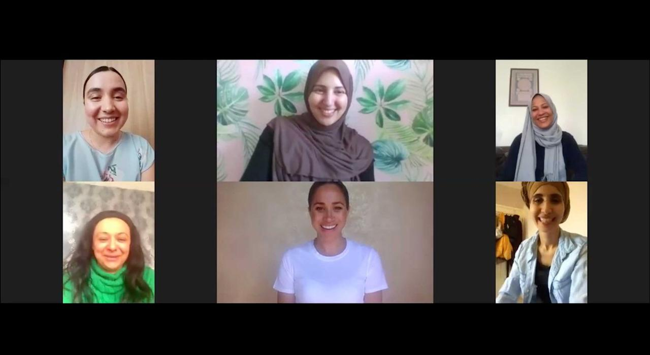 <p>Meghan spoke with women from the Hubb Community kitchen via video call, wearing a simple white t-shirt with her hair pulled back in a sleek bun. </p>