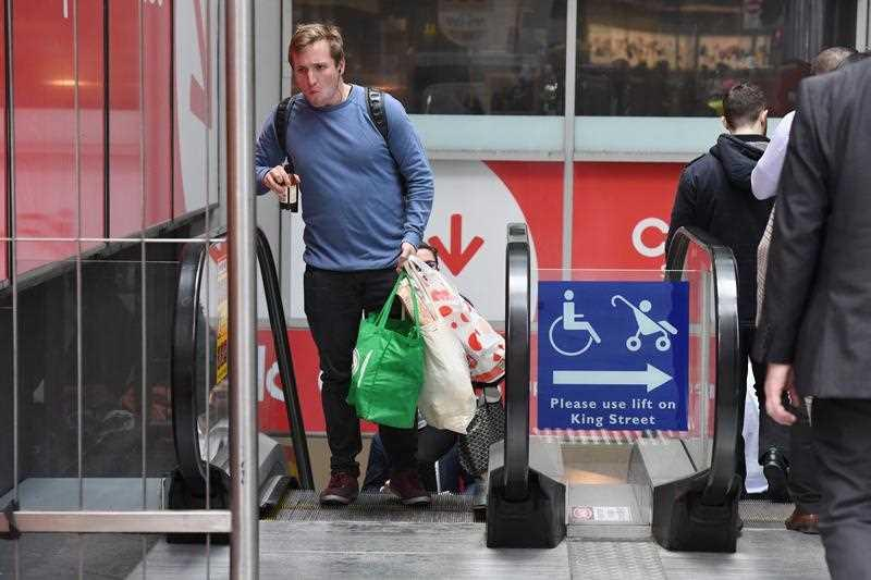 A shopper is seen carrying bags at a Coles Sydney CBD store.