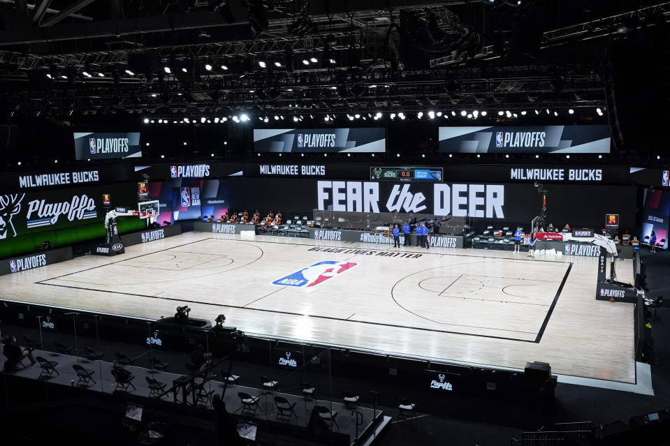 LAKE BUENA VISTA, FLORIDA - AUGUST 26: Officials stand beside an empty court after the scheduled start of game five between the Milwaukee Bucks and the Orlando Magic in the first round of the 2020 NBA Playoffs at AdventHealth Arena at ESPN Wide World Of Sports Complex on August 26, 2020 in Lake Buena Vista, Florida. According to reports, the Milwaukee Bucks have boycotted their game 5 playoff game against the Orlando Magic to protest the shooting of Jacob Blake by Kenosha, Wisconsin police. NOTE TO USER: User expressly acknowledges and agrees that, by downloading and or using this photograph, User is consenting to the terms and conditions of the Getty Images License Agreement. (Photo by Ashley Landis-Pool/Getty Images)