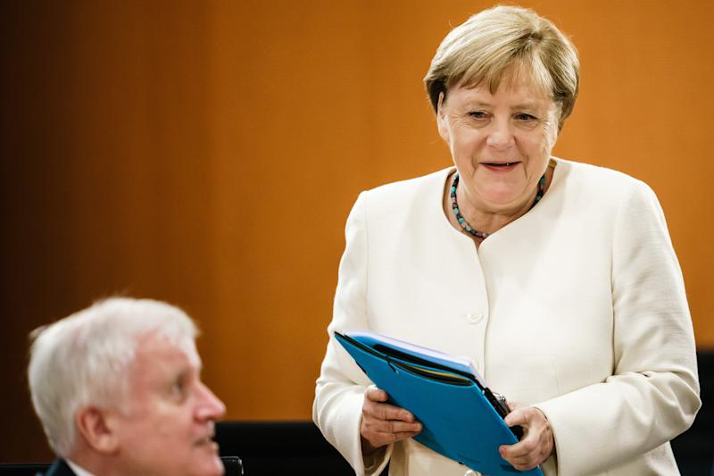 BERLIN, GERMANY - SEPTEMBER 23: German Chancellor Angela Merkel speaks to German Minister of Interior, Construction and Homeland Horst Seehofer during the weekly Government Cabinet meeting on September 23, 2020 in Berlin, Germany. (Photo by Clemens Bilan - Pool/Getty Images)