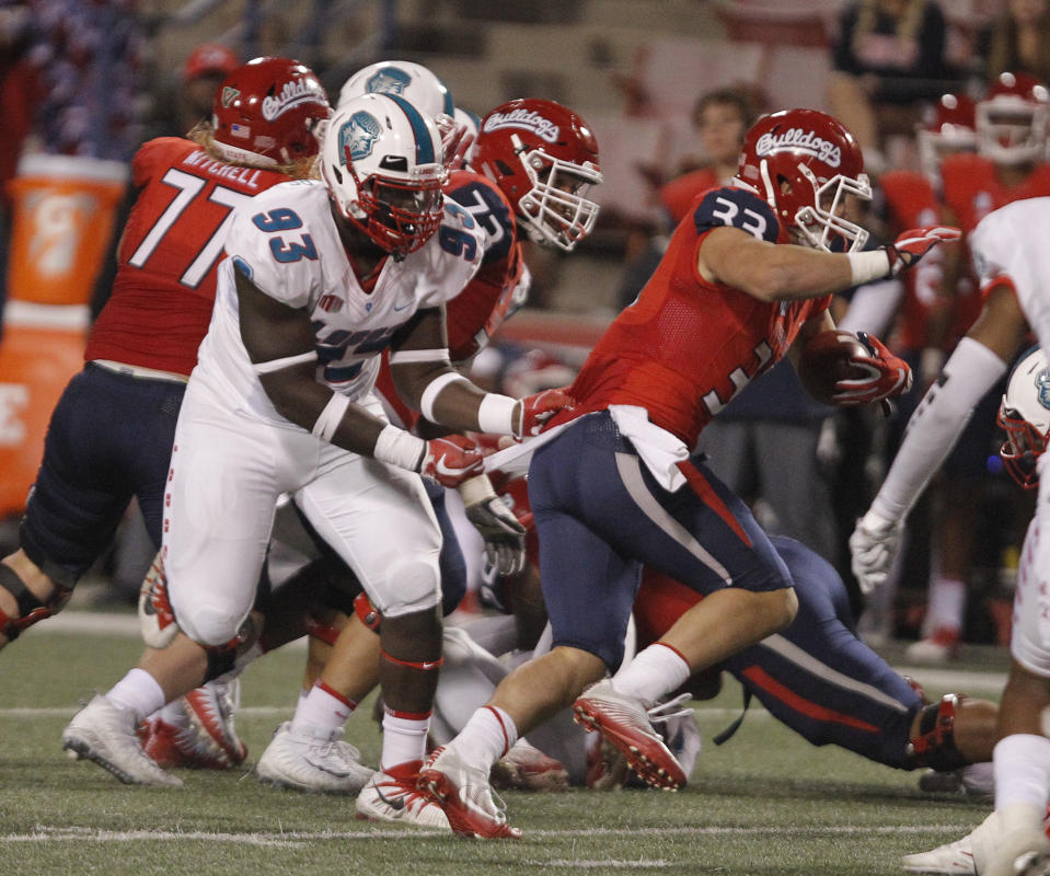Fresno State's Josh Hokit runs downfield against New Mexico's Nahje Flowers during the second half of an NCAA college football game in Fresno, Calif., Saturday, Oct. 14, 2017. Fresno State won 38-0. (AP Photo/Gary Kazanjian)