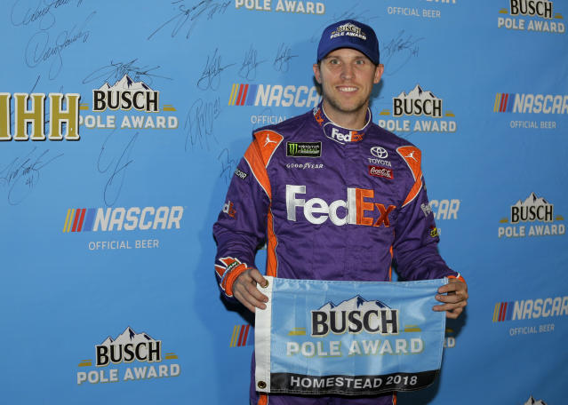 Denny Hamlin poses for a photo after winning the pole position during qualifying for the NASCAR Cup Series auto race at the Homestead-Miami Speedway, Friday, Nov. 16, 2018, in Homestead, Fla. (AP Photo/Terry Renna)