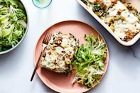 """Thinly sliced squash, kale, and plenty of ricotta cheese combine to create this hearty lasagna-like casserole. Quick-pickled raisins add brightness; hazelnuts bring the crunch. <a href=""""https://www.epicurious.com/recipes/food/views/cheesy-delicata-squash-and-kale-casserole?mbid=synd_yahoo_rss"""" rel=""""nofollow noopener"""" target=""""_blank"""" data-ylk=""""slk:See recipe."""" class=""""link rapid-noclick-resp"""">See recipe.</a>"""