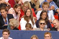 <p> Watching the Concert for Diana benefit at Wembley Stadium alongside siblings James and Pippa. </p>