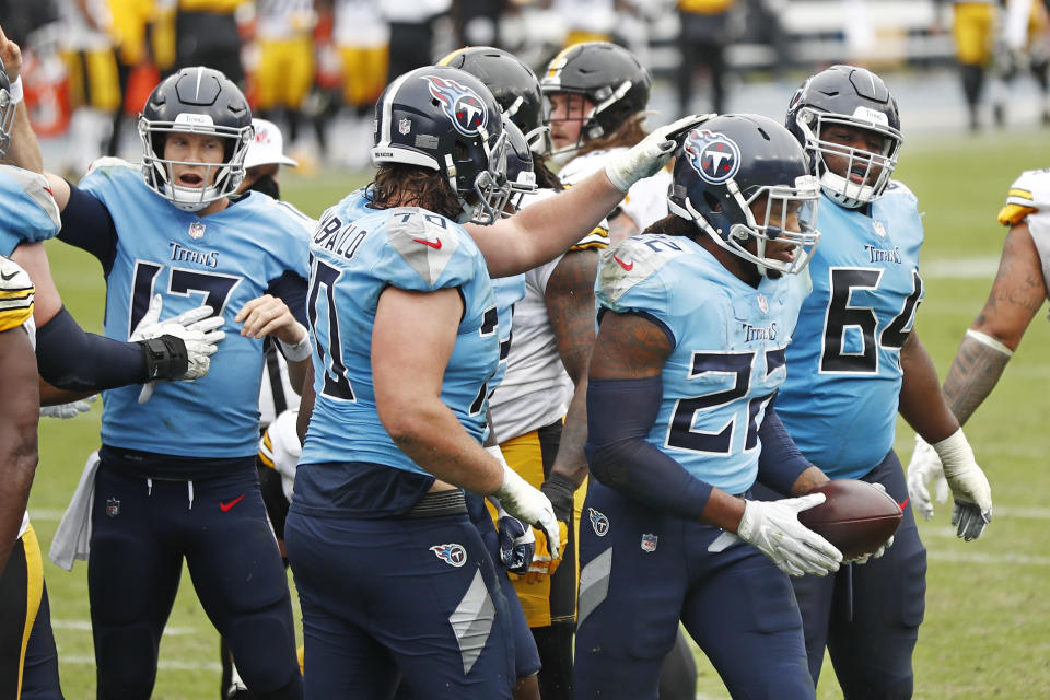 Tennessee Titans running back Derrick Henry (22) is congratulated by offensive tackle Ty Sambrailo (70) after Henry scored a touchdown against the Pittsburgh Steelers in the second half of an NFL football game Sunday, Oct. 25, 2020, in Nashville, Tenn. (AP Photo/Wade Payne)