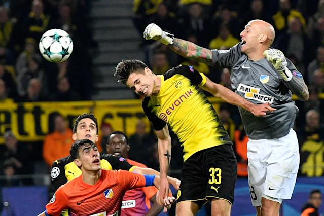 <p>Dortmund's Julian Weigl, left center, jumps for the ball with APOEL's goalkeeper Nauzet Perez during the Champions League group H soccer match between Borussia Dortmund and APOEL Nicosia in Dortmund, Germany, Wednesday, Nov. 1, 2017. (AP Photo/Martin Meissner) </p>