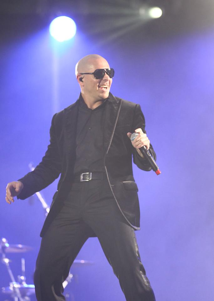 Pitbull was clad in head-to-toe black.