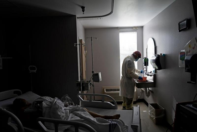 A member of the medical staff wearing full PPE prepares a disinfectant solution to wipe a deceased patient in the Covid-19 intensive care unit at the United Memorial Medical Center in Houston on June 30th.