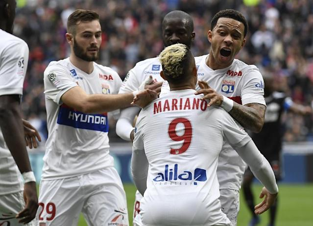 Lyon are locked in a battle with Marseille for the third and final Champions League berth in France (AFP Photo/PHILIPPE DESMAZES)