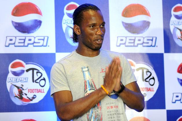International football player Didier Drogba gestures during a press conference at a function in New Delhi on June17, 2012.  Didier Drogba is in the city for the grand finale of the Pepsi T20 football tournament.   AFP PHOTO/ SAJJAD HUSSAIN