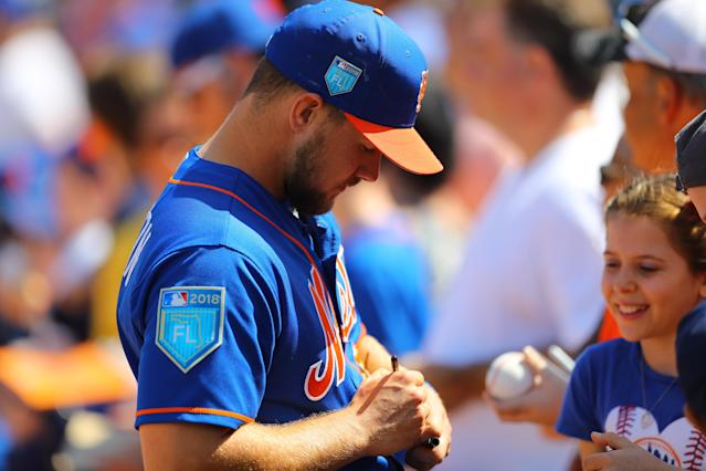 <p>New York Mets minor leaguer and Florida native David Thompson signs for fans before the baseball game against the Miami Marlins at Roger Dean Chevrolet Stadium in Jupiter, Fla., March 3, 2018. (Photo: Gordon Donovan/Yahoo News) </p>