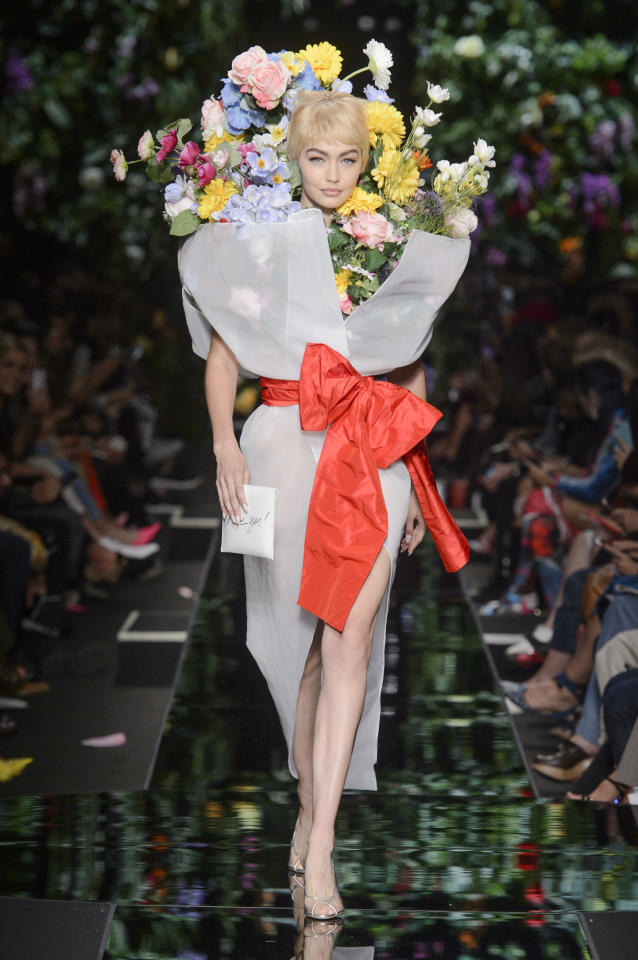 <p>Gigi Hadid channeling a bouquet of flowers at the SS18 Moschino show. (Photo: ImaxTree) </p>