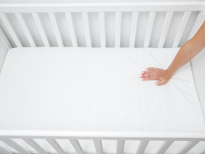 Bear in mind, not all baby beds come with a mattress, so you'll need to factor that in when considering your budgetiStock