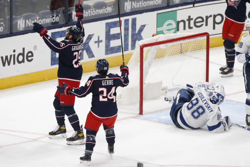 Columbus Blue Jackets players celebrate their goal against the Tampa Bay Lightning during the first period of an NHL hockey game Saturday, Jan. 23, 2021, in Columbus, Ohio. (AP Photo/Jay LaPrete)