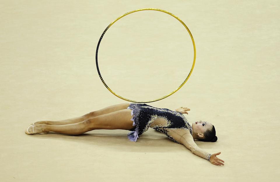 Anna Alyabyeva of Kazakhstan in action in the Individual All-Around during the FIG Rhythmic Gymnastics Olympic Qualification round in London.