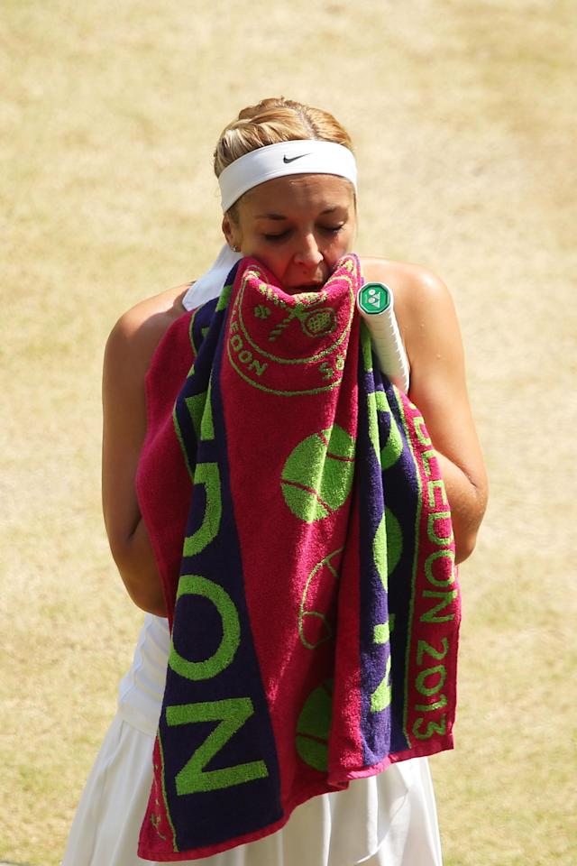 LONDON, ENGLAND - JULY 06: Sabine Lisicki of Germany wipes her face with a towel during the Ladies' Singles final match against Marion Bartoli of France on day twelve of the Wimbledon Lawn Tennis Championships at the All England Lawn Tennis and Croquet Club on July 6, 2013 in London, England. (Photo by Clive Brunskill/Getty Images)
