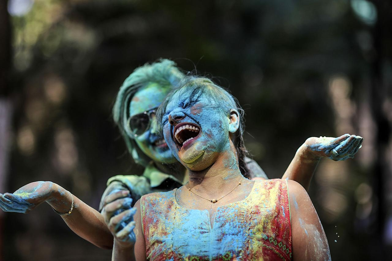 <p>A woman reacts after having colored powder smeared on her face by a friend friend during Holi celebrations in Mumbai, India, on Monday, March 13, 2017. (Dhiraj Singh/Bloomberg via Getty Images) </p>