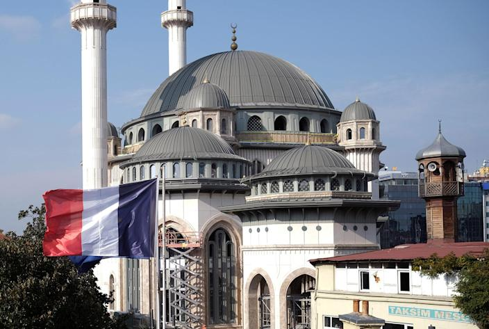 Image: A French flag flutters above the French Consulate, with a new mosque under construction in the background, in central Istanbul, (Murad Sezer / Reuters)