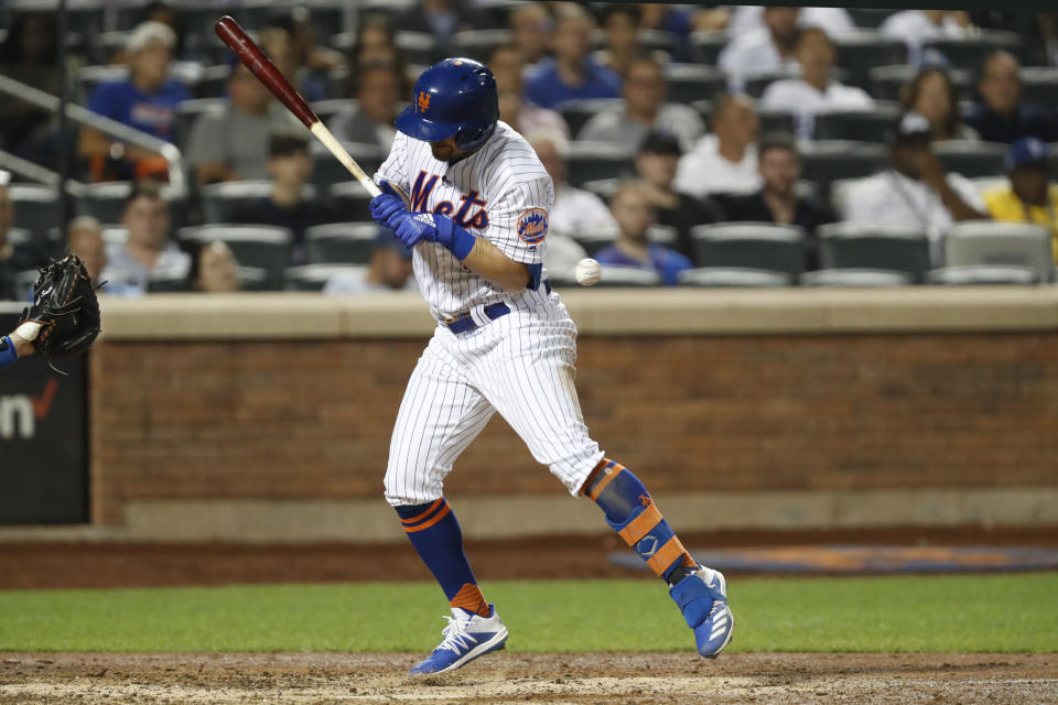 New York Mets' J.D. Davis (28) reacts as he is hit by a Dustin May pitch in the seventh inning of a baseball game against the Los Angeles Dodgers, Sunday, Sept. 15, 2019, in New York. (AP Photo/Kathy Willens)