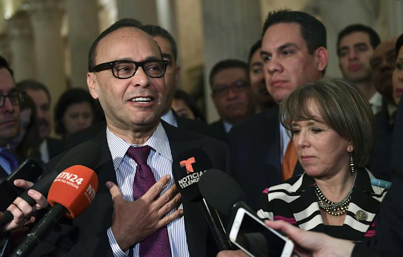 Rep. Luis Gutierrez, D-Ill., left, with Rep. Michelle Lujan Grisham, D-N.M., right, and Rep. Pete Aguilar, D-Calif., second from right