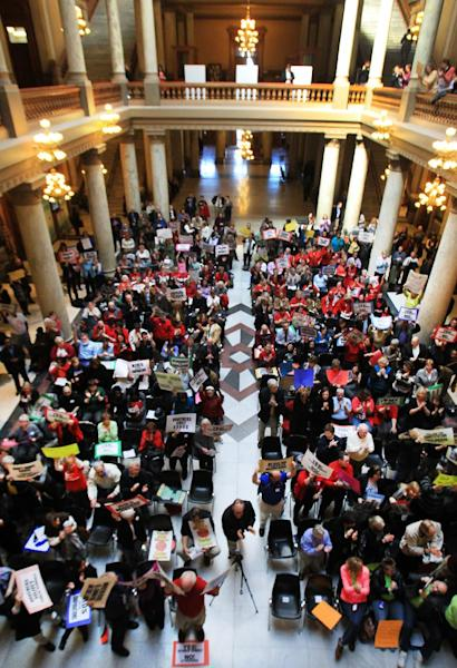 In a Tuesday, March 19, 2013 photo, traditional public school supporters rally in the North Atrium of the Indiana Statehouse. The Indiana Supreme Court on Tuesday, March 26, 2013 upheld the law creating the nation's broadest school voucher program, clearing the way for a possible expansion. In a 5-0 vote, the justices rejected claims that the law primarily benefited religious institutions that run private schools and accepted arguments that it gave families choice and allowed parents to determine where the money went.(AP Photo/The Indianapolis Star, Charlie Nye) NO SALES