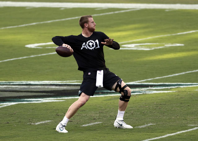 FILE - In this Sept. 6, 2018, file photo, Philadelphia Eagles quarterback Carson Wentz throws a pass before the team's NFL football game against the Atlanta Falcons in Philadelphia. Wentz will be back under center for the Philadelphia Eagles (1-1) against the Indianapolis Colts (1-1) on Sunday after watching his teammates win the Super Bowl without him in February and missing the first two games of this season. (AP Photo/Michael Perez, File)