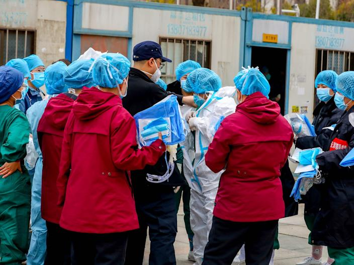 wuhan coronavirus medical worker protective suit sports center arena