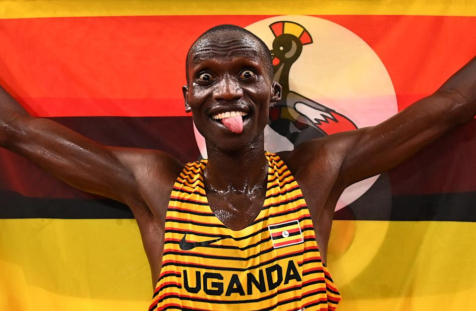 <p>Joshua Cheptegei of Team Uganda celebrates after winning gold in the Men's 5000m Final on day fourteen of the Tokyo 2020 Olympic Games at Olympic Stadium on August 6, 2021 in Tokyo, Japan. (Photo by Dylan Martinez - Pool / Getty Images)</p>