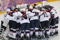 Team USA huddles before facing Canada in the women's gold medal ice hockey game at the 2014 Winter Olympics, Thursday, Feb. 20, 2014, in Sochi, Russia. (AP Photo/Petr David Josek)