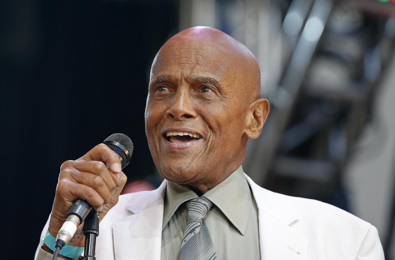 "FILE - In this July 20, 2014 file photo, singer and activist Harry Belafonte speaks during a memorial tribute concert for folk icon Pete Seeger at Lincoln Center's Damrosch Park in New York. Belafonte says it's unfair that actor-filmmaker Nate Parker's film ""The Birth of a Nation"" is being overshadowed by a 17-year-old rape case, but the iconic performer and activist added that he's not clear about the facts. (AP Photo/Kathy Willens, File)"