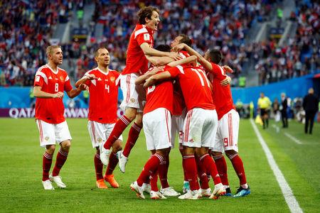 Soccer Football - World Cup - Group A - Russia vs Egypt - Saint Petersburg Stadium, Saint Petersburg, Russia - June 19, 2018   Russia celebrate their first goal scored by Egypt's Ahmed Fathy      REUTERS/Fabrizio Bensch
