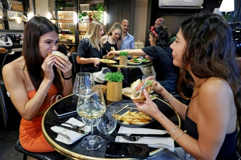 It looks like chicken and tastes like chicken; but Israeli diners are tucking into laboratory-grown and environmentally friendly 'meat'
