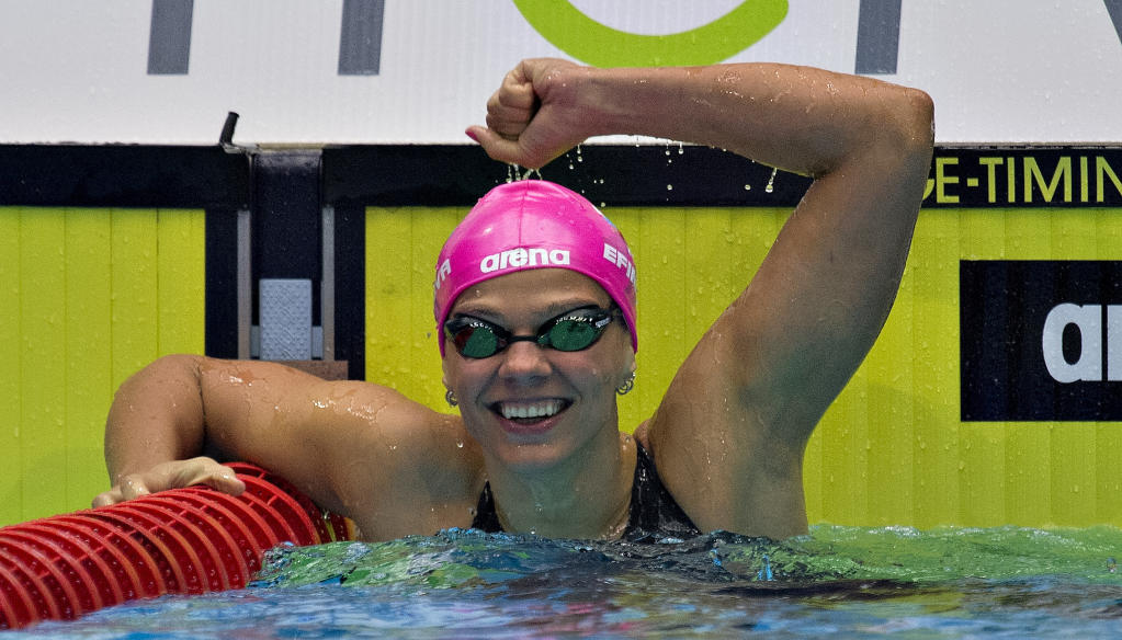 Yulia Efimova of Russia celebrates wining the women's 200 meters breaststroke at the Len European Short Course Swimming Championships in 2013. AFP PHOTO/SCANPIX DENMARK CLAUS FISKER (AFP Photo/CLAUS FISKER)