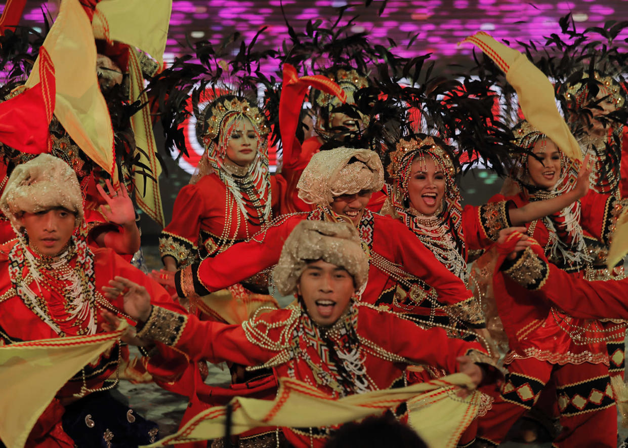 Performers dance in a night parade to celebrate Chinese New Year in Hong Kong, Saturday, Jan. 28, 2017. The Lunar New Year this year marks the Year of the Rooster in the Chinese calendar. (AP Photo/Vincent Yu)