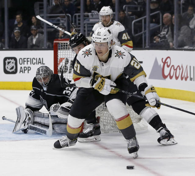 Vegas Golden Knights center Cody Eakin (21) controls the puck with Los Angeles Kings center Tyler Toffoli (73) trailing and goalie Jonathan Quick (32) watching during the third period of Game 4 of an NHL hockey first-round playoff series in Los Angeles, Tuesday, April 17, 2018. Vegas won 1-0, becoming the first expansion team in NHL history to sweep its first playoff series. (AP Photo/Alex Gallardo)