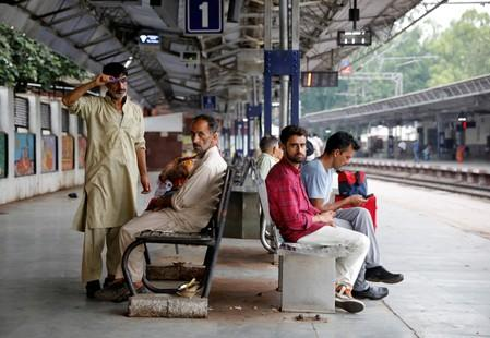 Danish Maqbool Malik waits to board a train at a railway station after meeting his brother Uzair Maqbool Malik in a central jail, in Agra