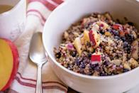 """Apples, blueberries, and almonds make this a filling, satisfying, healthy breakfast. <a href=""""https://www.epicurious.com/recipes/food/views/quick-breakfast-quinoa-bowl?mbid=synd_yahoo_rss"""" rel=""""nofollow noopener"""" target=""""_blank"""" data-ylk=""""slk:See recipe."""" class=""""link rapid-noclick-resp"""">See recipe.</a>"""