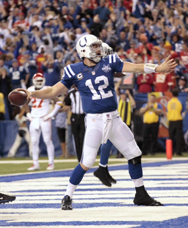 Indianapolis Colts quarterback Andrew Luck (12) celebrates after scoring a touchdown against the Kansas City Chiefs during the second half of an NFL wild-card playoff football game Saturday, Jan. 4, 2014, in Indianapolis. (AP Photo/AJ Mast)