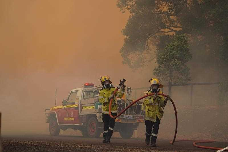 DFES fire fighters pictured battling a blaze in Brigadoon, Perth.