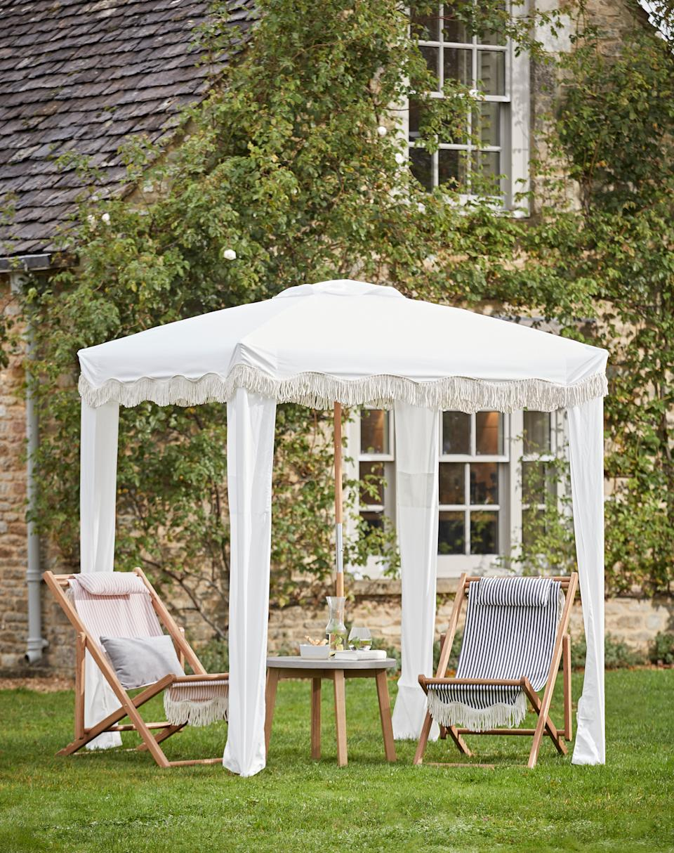 Garden trends: white canopies with seating Cox & Cox